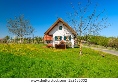 Traditional house on green field rural landscape village, Burgenland, Austria