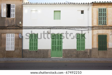 traditional house with green closed shutters on windows in a small city on Majorca island - stock photo