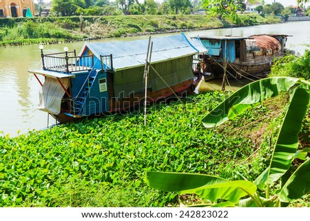 traditional houseboats on the river Chao Phraya in Ayutthaya, Thailand - stock photo