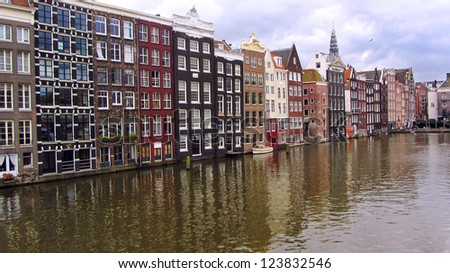 Traditional houses along the canal of Amsterdam - stock photo