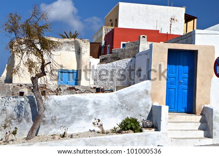 Traditional houses at Santorini island in the Cyclades of Greece - stock photo
