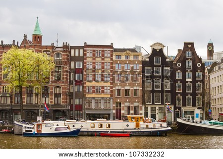 Traditional houses near the canal in Amsterdam, the Netherlands - stock photo