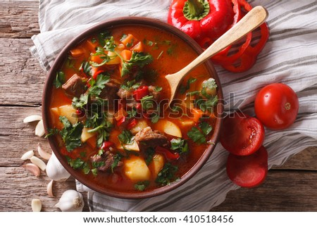 Traditional Hungarian goulash soup bogracs close-up in a bowl on the table. horizontal view from above