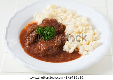 Traditional Hungarian hot goulash soup with small dumplings - stock photo