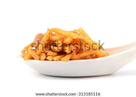 Traditional indian deep fried falahari chivda- chivda or mixture in spoon on white background