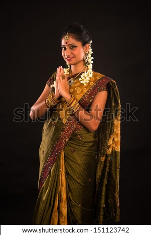 traditional indian female greeting with dark background  - stock photo