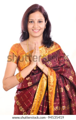 Traditional Indian girl holding hands in prayer position