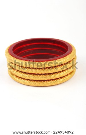 traditional indian gold bangles isolated on white