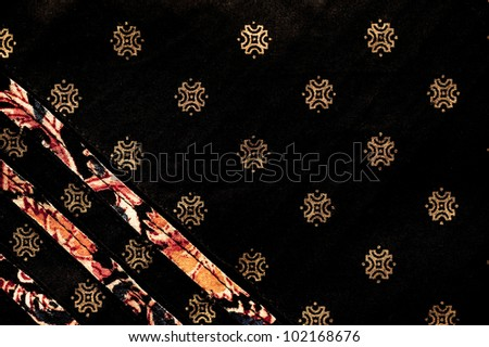 Traditional Indian hand printed fabric with gold pattern - stock photo