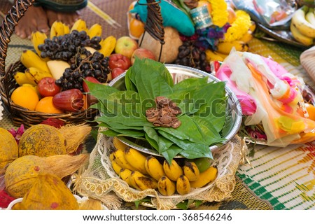 Traditional Indian Hindu religious praying items in ear piercing ceremony for children. Focus on the betel leaves. India special rituals events. - stock photo