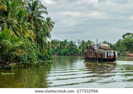 Traditional Indian houseboat near Alleppey  on Kerala backwaters  - stock photo