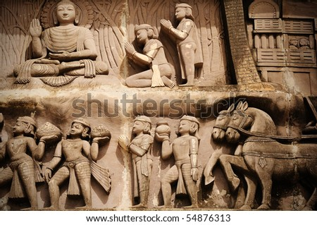 Traditional Indian sculpture showing disciples worshipping Buddha - stock photo