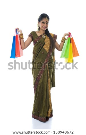 traditional indian woman doing diwali shopping with isolated white background