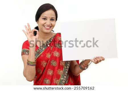 Traditional Indian woman holding a billboard   - stock photo