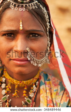 Traditional Indian woman in sari costume covered her head with veil, India people.
