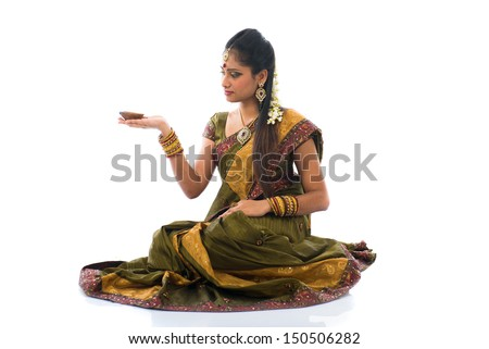 traditional indian woman with oil lamp during the celebration of deepawali or diwali on white background - stock photo