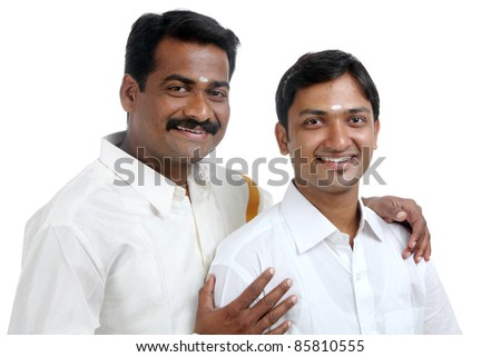 Traditional Indian young people posing to the camera. - stock photo
