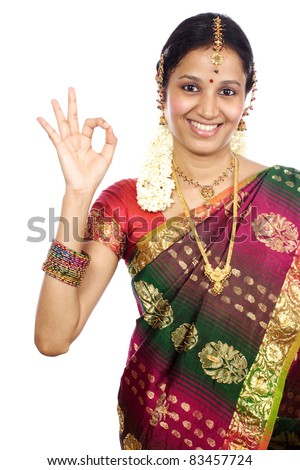 Traditional Indian Young woman making Ok sign - stock photo