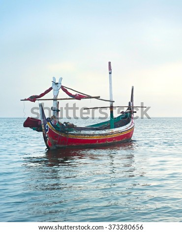 Traditional Indonesian fishing boats in the ocean, Java island, Indonesia - stock photo
