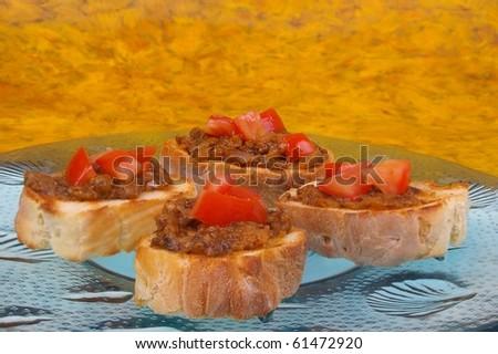 "Traditional Iranian Eggplant dip ""Kashk e baadenjaan""  served on bread with tomato - stock photo"