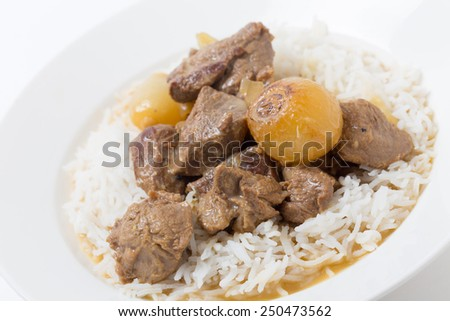 Traditional Italian and Greek lamb fricassee with small onions, finished with an egg and lemon sauce. - stock photo