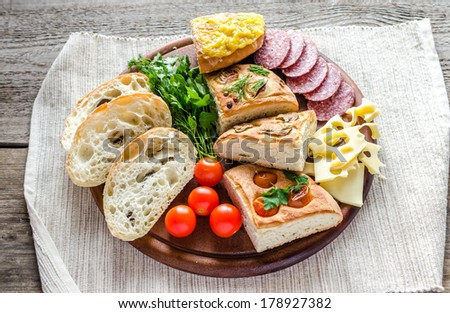 Traditional italian bread with cheese and salami - stock photo
