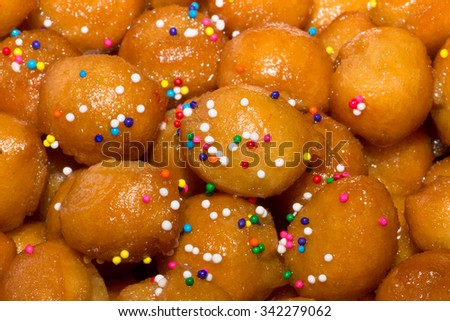 traditional Italian Christmas stuffoli honey balls - stock photo