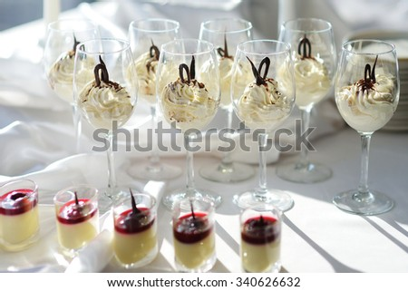 Traditional italian cream cheese dessert served in wine glasses - stock photo