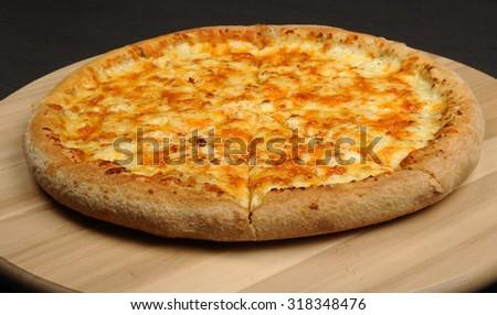 Traditional italian cuisine - Pizza Quattro Formaggi  - stock photo