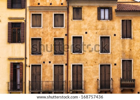 Traditional Italian Facade with balconies - stock photo