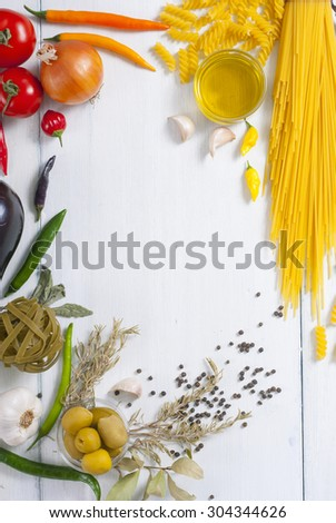 traditional italian food ingredients on white wood table - stock photo
