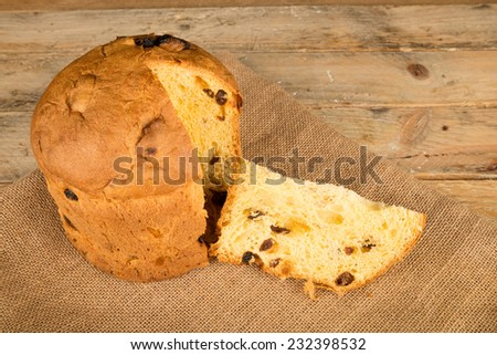 Traditional Italian panettone  on a rustic wooden background - stock photo