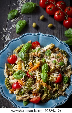Traditional Italian pasta with artichokes, basil and parmesan cheese - stock photo