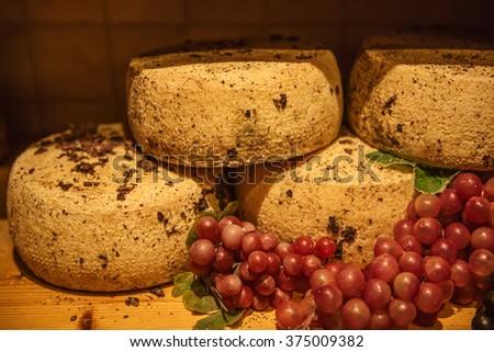 Traditional italian pecorino cheese in the organic shop in Pienza, Italy - stock photo