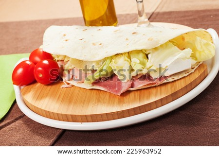 Traditional Italian piadina on the table - stock photo