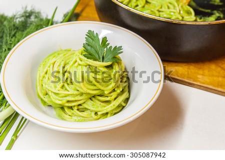 Traditional Italian spaghetti with pesto - stock photo