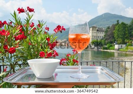 Traditional Italian Spritz cocktail against lake Como, Italy - stock photo