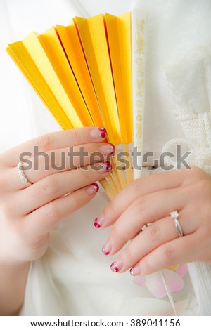 Traditional Japanese ceremony wedding lovely day, young married bride holding golden paper fan hands in white background - stock photo
