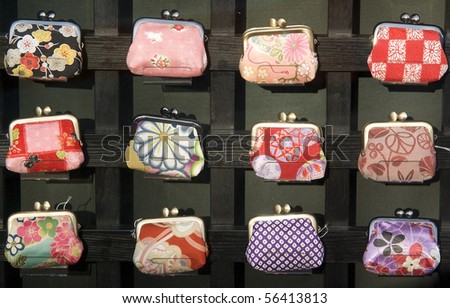 Traditional japanese colorful purses at market stall - stock photo