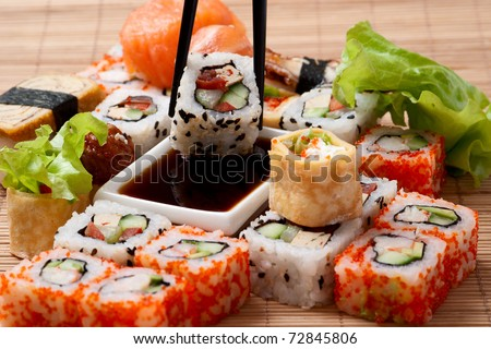 Traditional Japanese food Sushi. Closeup japanese sushi on a bamboo napkin. Sushi collection - stock photo