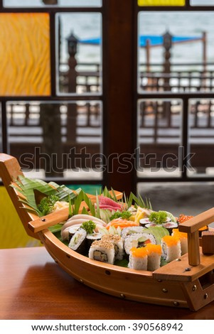 Traditional Japanese food Sushi with boat. Closeup japanese sushi on a boat. Sushi collection - stock photo