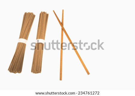 Traditional Japanese soba noodles and chopsticks on white - stock photo