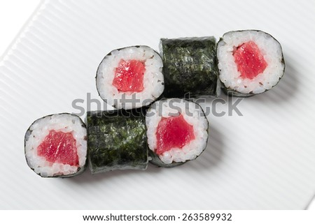 Traditional japanese sushi roll with tuna. As a whole background. - stock photo