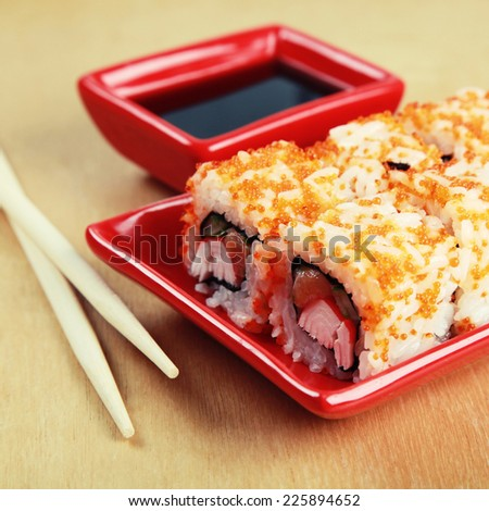 Traditional Japanese Sushi rolls with crabs, salmon, caviar and rice, instagram effect, square toned image - stock photo