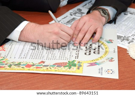 Traditional jewish wedding, signing prenuptial agreement  ketubah. Jewish marriage contract. - stock photo