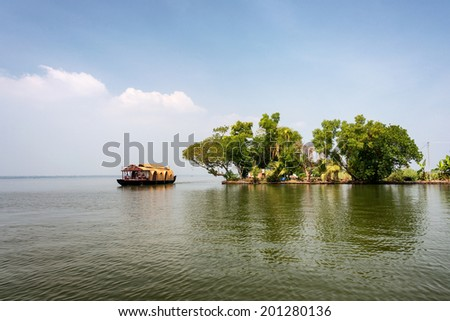 "Traditional Keralan house boat, ""Kettuvallam"" sailing in Keralan backwaters."