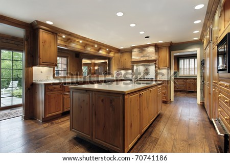 Traditional kitchen in luxury home with oak wood cabinetry - stock photo
