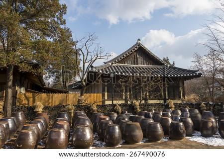 Traditional Korean house with rows of kimchi jars at the courtyard - stock photo