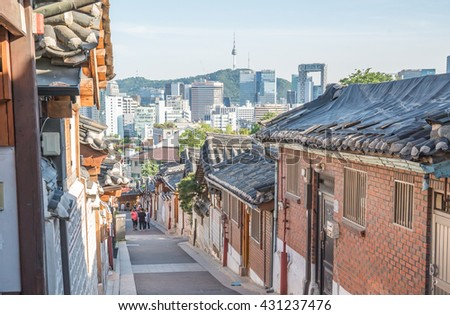 Traditional Korean style architecture at Bukchon Hanok Village in Seoul, South Korea. - stock photo