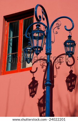 Traditional light in the neighborhood ol La Boca, in Buenos Aires, Argentina. - stock photo
